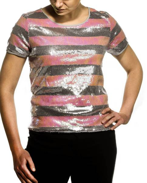 Those black pants, pencil skirt or little black dress are your wardrobe workhorses. To let your inner show horse out, top any of those dark basics with a sequined T-shirt. I found them in black, cream, copper and colors in stores across the price spectrum. This striped one in unexpected pink and gray is less than $20 and it's all you need for a 200-watt look. And, by the way, when it comes to sparkle, stick to a single item, two at most. Too much gleam and you're venturing into more-is-less territory.<br><br>