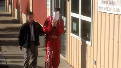 Dion Wilt is escorted by Conemaugh Township police Detective Michael Popma after Wilt waived his right to a preliminary hearing Wednesday.
