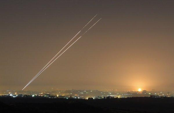 During the last hour of hostilities with Israel before a cease-fire took effect Wednesday, militants launch rockets from Gaza City.