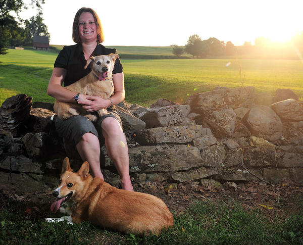 Jennifer A. Fitch of Waynesboro, Pa., a reporter for The Herald-Mail Media, is shown with her two dogs. Fitch wrote a book for children based on what happened when one of her dogs, Carson, ran away. He later returned on his own.