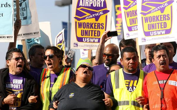 Union protesters lock arms and chant during the demonstration near LAX on Wednesday.