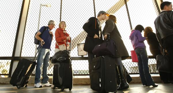 Travelers wait in a line at Los Angeles International Airport the morning before Thanksgiving.