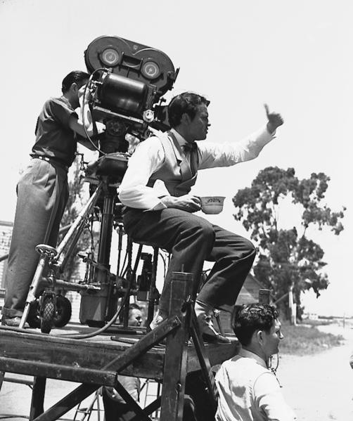 "Orson Welles directs a scene from ""Citizen Kane"" on location in Hollywood in July 1940, with cinematographer Gregg Toland handling the camera. Welles also starred in the film."