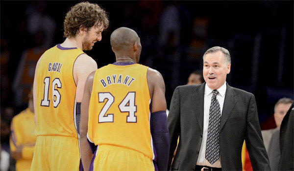 New Lakers Head Coach Mike D'Antoni welcomes Pau Gasol and Kobe Bryant as they leave the court following the Lakers' win over the Nets, 95-90.