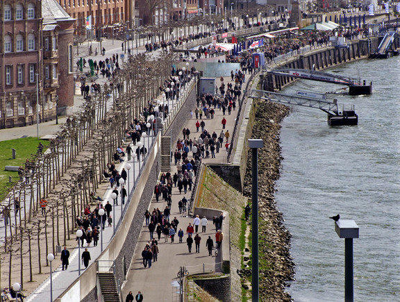 Visitors and locals alike enjoy a stroll along the Rhine River in Dusseldorf, Germany.