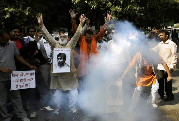 A group in New Delhi sets off firecrackers and chants to celebrate the execution of the lone surviving gunman in the 2008 Mumbai terrorist attack.