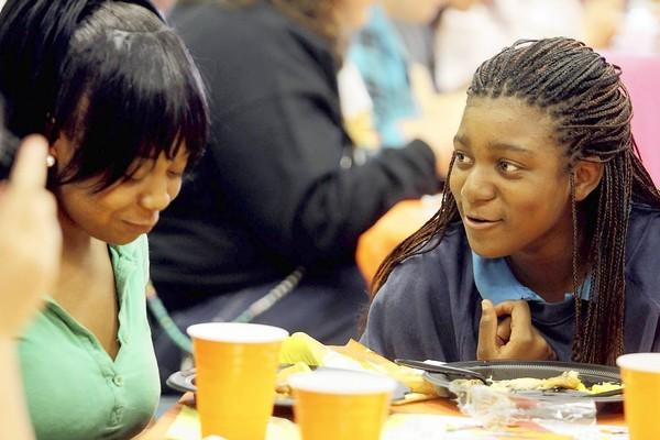 Sequoia Henry, left, and her sister, Sashauna, enjoy a Thanksgiving lunch at the PACE Center for Girls in Wilton Manors. The center is for girls 12-17 where at-risk girls get academics, counseling and help with transition to their home school.