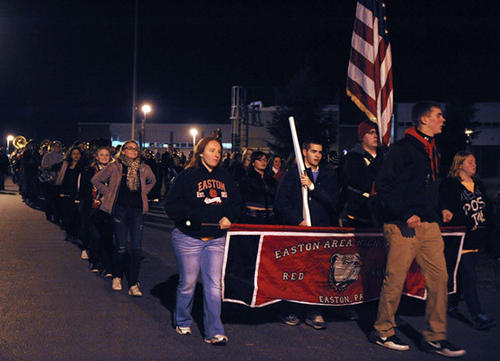 The parade walked to the Easton High School bonfire the night before the Thanksgiving Day game against Phillipsburg.