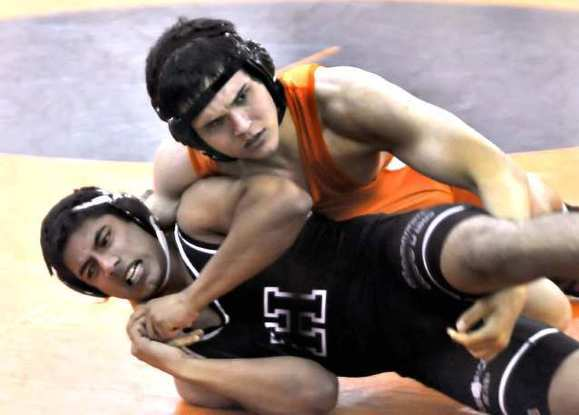 ARCHIVE PHOTO: The members of the Hoover High boys' wrestling team say they're ready for new challenges in the second year of the program's existence.