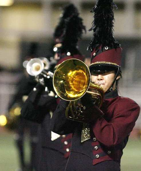 "The La Canada High School marching band performs a song from their show entitled ""Mechanize"" for parents at the high school on Friday. After the brief performance at the school, the band traveled to Clovis to compete in the WBA Championships for the weekend."