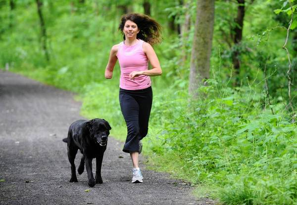 Jacqui Jarret runs down a section of the The D & L Trail in Bethlehem Township with Friday her labrador.