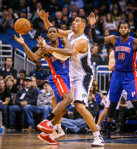 Magic center Gustavo Ayon (19) is called for a foul as he battles Detroit's Brandon Knight (7) for control of the ball during fourth quarter action of a game against the Detroit Pistons at Amway Center in Orlando, Fla. on Wednesday November 21, 2012.