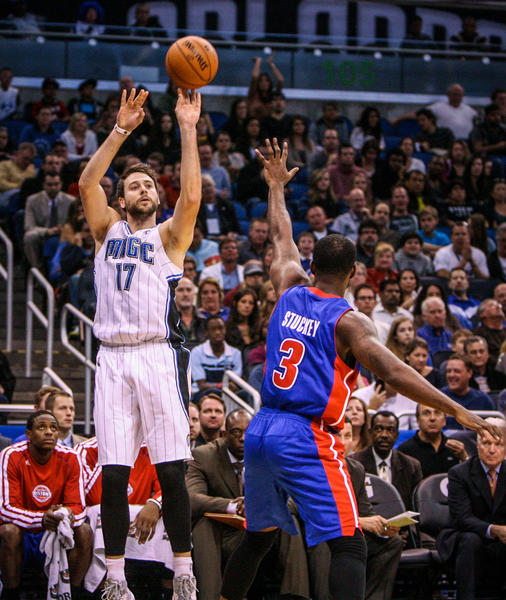 Magic forward Josh McRoberts (17) shoots a three pointer over Detroit's Rodney Stuckey (3) during fourth quarter action of a game against the Detroit Pistons at Amway Center in Orlando, Fla. on Wednesday November 21, 2012.