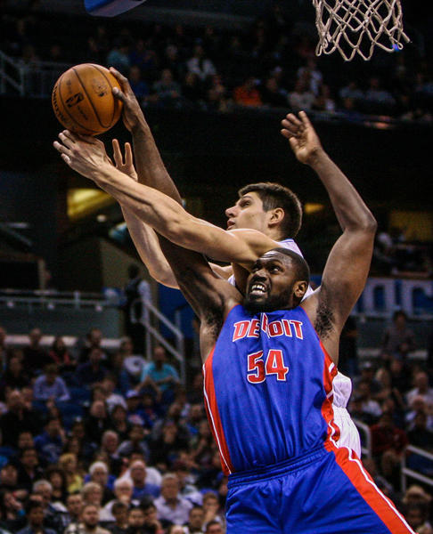Magic center Nikola Vucevic (9) battles Detroit's Jason Maxiell (54) for the rebound during fourth quarter action of a game against the Detroit Pistons at Amway Center in Orlando, Fla. on Wednesday November 21, 2012.
