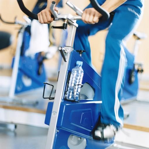 Man's legs on exercise bike