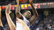 LEXINGTON, Ky. (AP) - Archie Goodwin doesn't back down from contact. Alex Poythress is getting used to it.