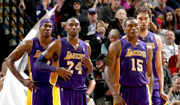 Dwight Howard, Kobe Bryant, Metta World Peace, and Pau Gasol stand together during a time out in the Lakers' 113-97 loss to the Sacramento Kings.