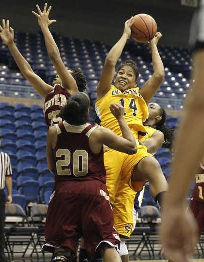 UC Irvine's Jasmine Bernard (14) goes up for an offensive rebound during the first half against Denver at the Bren Events Center on Wednesday.