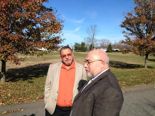 Marty Coladarci, a CL&P account executive, and New Fairfield First Selectman John Hodge stand in front of a 4-acre parcel of the Faith Church's property along U.S. Route 202 in New Milford. Coladarci and Hodge are both members of the church, which is going to put 25 or more mobile homes on this field as temporary housing for Staten Island residents displaced by storm Sandy.