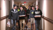 "<span style=""font-size: small;"">The Penn High School hockey team took a break from the ice to help those who have to spend this holiday in the hospital.</span>"