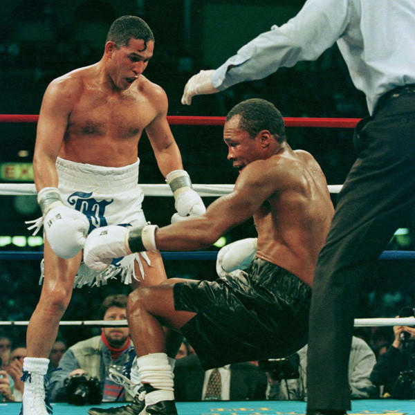 Sugar Ray Leonard falls as he is knocked down by Hector 'Macho' Camacho during the IBC Middleweight fight in Atlantic City in 1997.