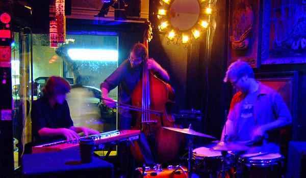 The late Austin Peralta, left, performing with his trio at Lot 1 Cafe in April 2011.