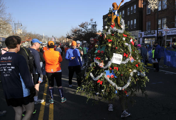 Curt Hirsch of Storrs wore a Christmas Tree costume for the 76th running of the Manchester Road Race on Thanksgiving Day.