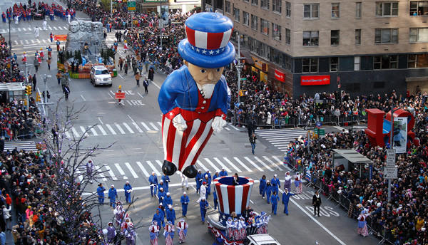A balloon float makes its way down 6th Ave during the Macy's Thanksgiving Day Parade in New York on Thanksgiving day.