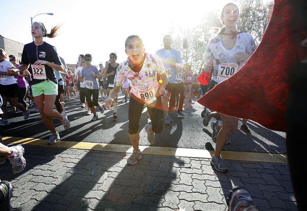 A solid wall of runners hit the streets Thursday morning for La Canada Flintridge's Thanksgiving Day Run.