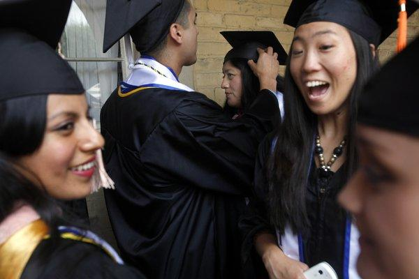 A federal judge in Miami has thrown out a Florida regulation that required students under the age of 25 and born to parents in the country illegally to pay higher, out-of-state tuition. Above: Undocumented UCLA graduates gathered near the campus to have their own graduation prior to the schoolwide ceremony in June.