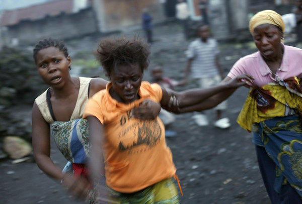 Congolese women flee fighting between Congolese soldiers and rebels around the eastern town of Sake, near Goma, on Thursday.