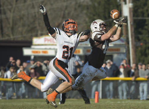 Northampton High School;s Jacob DeAngeles chases after Catasauqua's Zach Stopay attempts to catch a pass during the first quarter of a Thanksgiving Day Football game at Catasauqua High School's Alumni Field on Thursday.