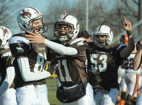 Catasauqua's (from left) Kevin Bond, Brandon Keks, and Andrew Gehringer celebrate after defeating Northampton High School in a Thanksgiving Day Football game rivalry at Catasauqua High School's Alumni Field on Thursday.