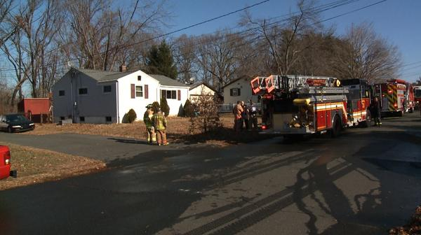Firefighters at a house fire on Laurie Drive in Enfield on Thursday.