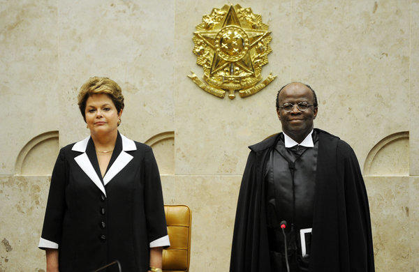 Brazilian President Dilma Rousseff, left,  with Joaquim Barbosa during his inauguration as Brazil's first black head of the Supreme Court.