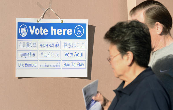 Signs in various languages direct voters to polling stations at the Alhambra Fire Station #71 in Los Angeles County.