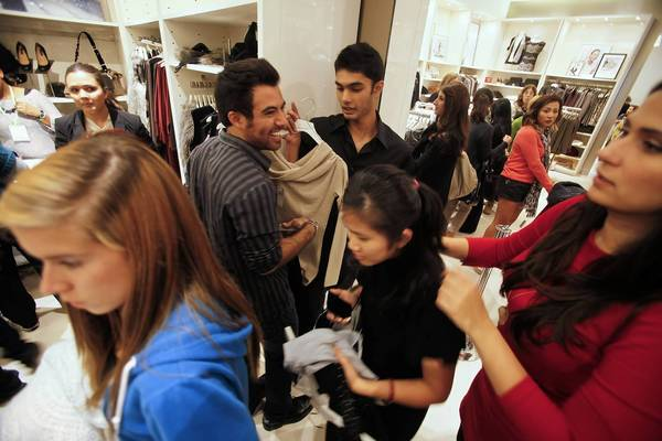 Consumers are reasserting themselves as the key driver of U.S. economic growth. Above, shoppers crowd into the Ann Taylor store at South Coast Plaza in Costa Mesa last year for Black Friday specials.
