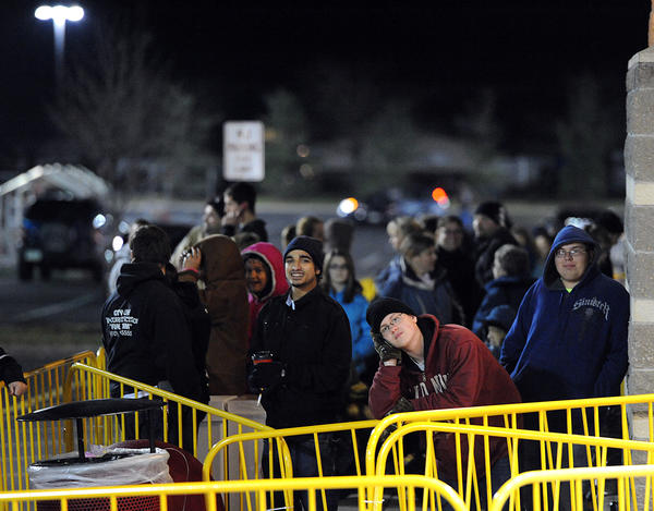 Alex Dilliard 16, of Allentown (right) waits in line outside of Target in South Whitehall Township to get an early start on sales on Thanksgiving night prior to Black Friday.