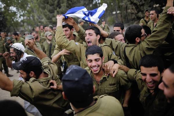 Israeli soldiers dance to music provided by visitors who turned up to show their support at the border with the Gaza Strip.