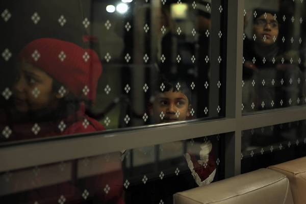 Children peer into Sears at Woodfield Mall as they await the store's 8 p.m. opening on Thanksgiving in Schaumburg.