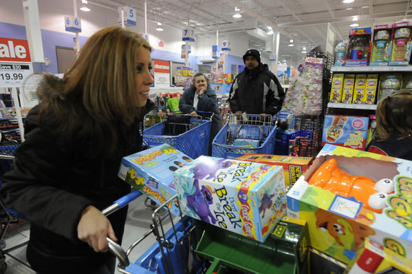 Ashley Sego, of Bristol navigates a traffic jam of shopping carts at Toys R Us in West Hartford.