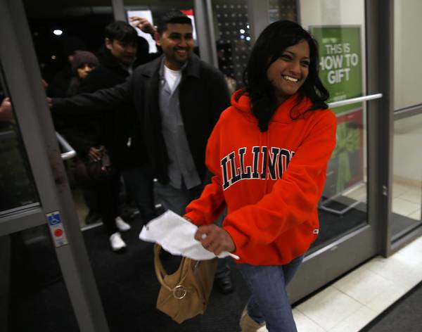Nimita Kansagara, of Streamwood, is the first customer through the door at Sears in Woodfield Mall after its 8 p.m. opening on Thanksgiving in Schaumburg. Kansagara arrived at 2 p.m. to buy a television.