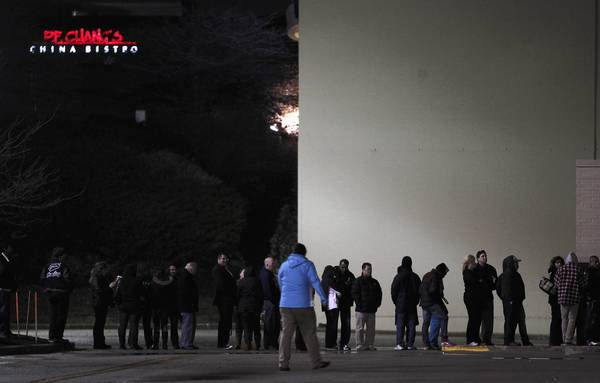 Bargain hunters wait in line at Sears in Woodfield Mall for an 8 p.m. opening on Thanksgiving in Schaumburg.