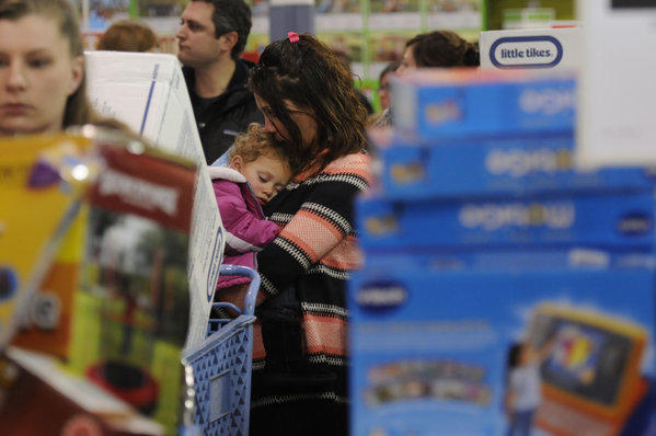 Angela Del Monaco holds her 21 month-old daughter, Mya. in the check-out line at Toys R Us. The Del Monacos live in Bristol.