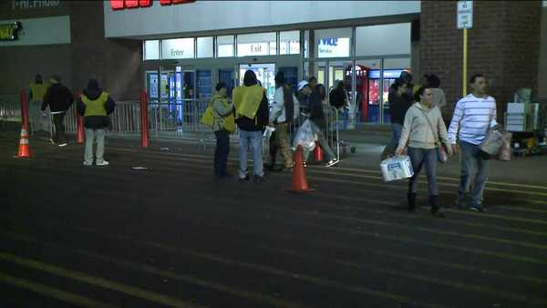 A steady flow of shopper come and go from Wal-Mart on Flatbush Avenue in Hartford Thursday night.