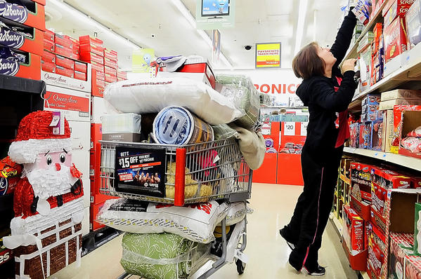 Leisl Dofflemyer of Hagerstown reaches for an item while Christmas shopping at Kmart in Hagerstown on Thanksgiving Day.