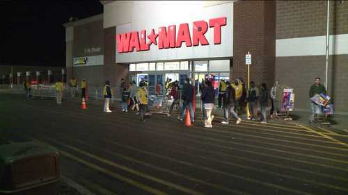 Shoppers at Wal-Mart in Hartford stop in to the store, which opened at 8 p.m., to start holiday shopping and take advantage of deals.