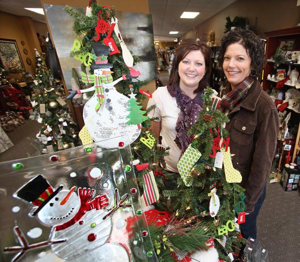 Karen Flakus, right, owner of Inspire with employee Jessica Lewis, left.