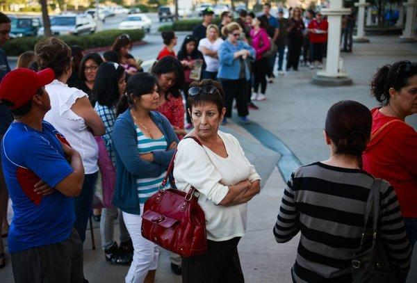 Shoppers wait in line for the first Black Friday deals.