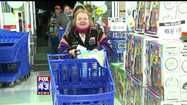 People dashed through the doors of the Mechanicsburg Toys R Us Thanksgiving night hoping to get their hands on some doorbuster deals.